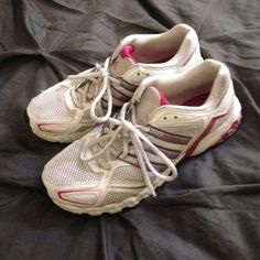 Adidas tennis shoes White & pink Adidas running shoes. Some wear, but these shoes still have plenty of life left in them. Last picture shows wear on pink next to soles as well as some minor wear on left shoelace. Priced accordingly. Adidas Shoes Athletic Shoes