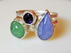 sterling silver gemstone stacking rings.  natural green and purple smoothe and faceted gemstones set in sterling bezels.  $110.00  by TiraJewelry on Etsy  #sterling silver gemstone artisan stacking rings