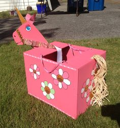 The magic unicorn to complete my daughter's fairy princess costume, made from a cardboard box