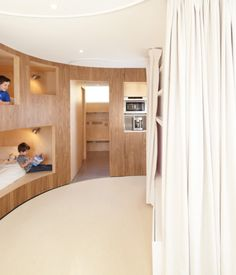 "The kids stow away into their custom bunk beds each night. ""Rather than trying to fit the furniture into the apartment, we decided to fit. Ikea Interior, Apartment Interior, Interior Decorating, Bunk Bed Curtains, Curtains Living, Solid Oak Furniture, Bedroom Furniture, Modern Bedroom Design, Bed Design"