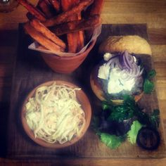 Lamb burger with feta, aubragine relish, a pot of sweet potatoes and 'The Garden' house slaw. #lovefood
