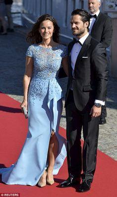Glamorous: Miss Hellqvist arrived wearing a stunning cornflower blue gown for her pre-wedd...