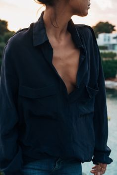Rumpled Style | Oversized, loose-fitting, navy, linen button down. Tucked into medium wash denim.