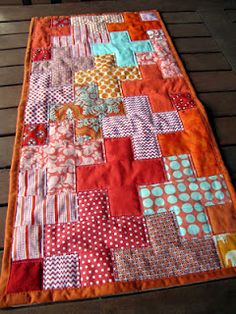 "This pattern uses 2.5 inch wide strips, so jelly rolls are suitable also. These are then cut in lengths of 2.5, 4.5 or 6.5 inches to make up the plus shapes. You can also use scraps as the longest piece needed is 11.5 x 2.5 (to make a ""full"" plus)."