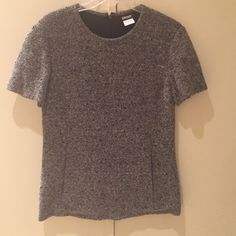 DKNY Short Sleeved Grey Sequined Wool Top Brand new! DKNY shirt with pockets and zipper in the back DKNY Tops
