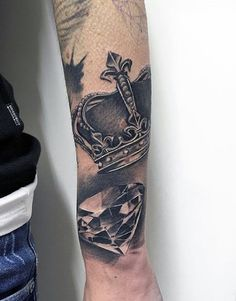 Guy With Shiny Crown And Diamond Tattoo Forearms