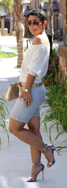 Casual summer fashion. Billowy top, cute shorts, and a pair of heels make for an awesome May/June look.