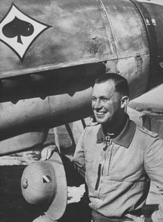 Smiling Luftwaffe Hauptmann from a Bf.109 fighter at an airfield in North Africa - pin by Paolo Marzioli
