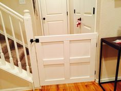 DIY Baby/Dog gate My husband did it again! We saw a lot of pins for baby gates and he came up with this creation out of some scrap wood we had in our garage Diy Dog Gate, Pet Gate, Dog Kennel Cover, Diy Dog Kennel, Indoor Gates, Baby Gates, Dog Gates, Dog Rooms, Dog Houses