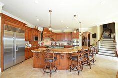 27707 Charter Lake Ln Katy, TX 77494: Photo Grand kitchen island with granite, wood accents, dual dishwashers and apron sink