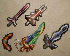 Terraria - Item Set #3 (keychains optional!) This time around we have some of the more powerful weapons! The Terra Blade and Tizona are the big ones out of this pack, and there's also the Orichalcum...