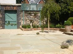 Sarah Jordan Gardens - Limestone paving with reclaimed brick edge