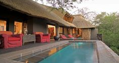 Singita Ebony Lodge. The secluded thatched suites are the epitome of elegant comfort, with rooms styled with an eclectic mix of colours, fabrics and textures. A colonial feel with Egyptian linen, African throws, antiques and modern luxuries combine to create a homely, lived-in feel. From the vast wooden deck to the pool overlooking the Sand River, it's not uncommon to see elephant, buffalo and antelope grazing only metres away at any time of day.