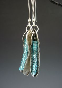 These gemmy beauties are the perfect earrings for summer. Sky blue apatite beads fit right into the curve of fold formed silver pods. To make the pods,