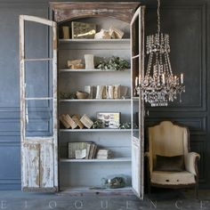 Stunning extra tall French antique cabinet with five equally spaced shelves. Glass doors and large functional handle lock. The outer cabinet is in Distressed Coffee Bean and the inner in a whitewashed Pale Dove.