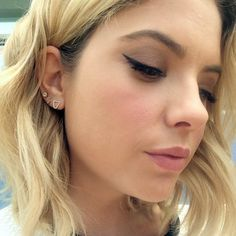 Ashley Benson's cat eye and earring stack <3