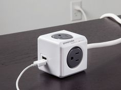 The PowerCube USB outlet adapter +10 ft, discovered by The Grommet, is cube shaped erasing the problem of having two plugs that won't fit next to each other.