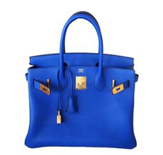 bae3da37232b This Hermes Birkin bag is a burst of blue with a touch of gold hardware.