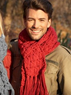 Fire Engine Scarf : This scarf with an interesting texture collide features a simple lace design, making it an engaging piece for beginning or novice knitters.
