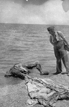 """This dead German paratrooper belonged to the Luftlande Sturm Regiment. He landed in the sea and drowned. He then later came drifting to the beach of Maleme."" Invasion of Crete,"