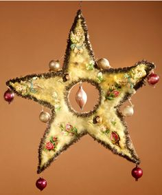 Victorian Christmas ornament. Cotton batting star with mini blown glass ball ornaments, tinsel trimmed.