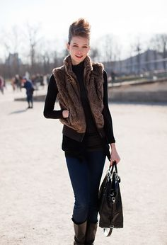 love this whole look...fur vest, hair and everything