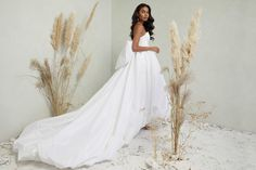 If you love Princess Diana's wedding dress or you're a bridal trendsetter, you'll want to hear the news: taffeta wedding dresses are back! The Cloud by Katherine Tash