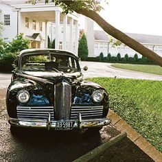 Nostalgic Getaway Car | The couple left the wedding in a vintage Packard. | SouthernLiving.com