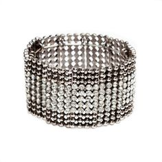 Love this! Found it on Journey Accessories Sleek, yet industrial, the Dani bracelet offers an unexpected band of shimmer, with a subtle row of crystals accenting beaded gunmetal. This stretchy slip on adds a quick dash of edgy shine to laid back and evening ensembles.  - #Gunmetal, #crystals - #Stretch fit $40
