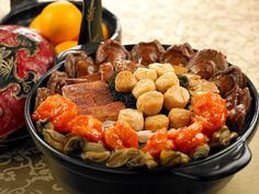 """Known as the """"Big Bowl Feast"""", Pen Cai is an indulgent combination of three layers of ingredients.  Served in a claypot, the feast is replete with 10-head abalone, black moss, fish maw, sea cucumber,  dried oyster, conpoy, bamboo pith, pig's trotter and yam; among 10 other ingredients. #CNY"""