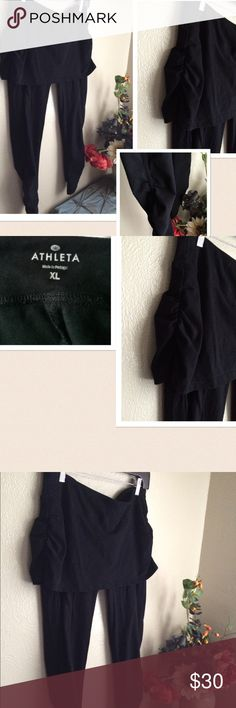 Athleta Yoga Pants Skirt 2 in 1 Cotton Organic Athleta Women's Athletic brand. Features: Skirt attached to legging with Shirred legs and sides of the skirt. Signature logo at the bottom of the right leg. 92% organic cotton 8% spandex. Preowned in Excellent condition. If this condition is not right for you do not purchase. Athleta Shorts