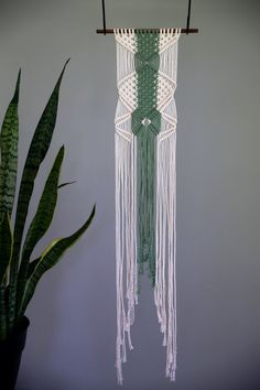 50% OFF // Discount already applied! ---  This macrame wall hanging was made from 3mm natural white cotton and hand dyed rope in a lovely green color. Hangs from a hand stained wooden dowel in a deep walnut color. A unique piece that is sure to add texture and color to any room! Would make a lovely gift!  Wooden dowel is 12, macrame measures approx. 8 wide by 43 long.  This item is one of a kind and READY TO SHIP! ✦ Shop Sale ✦ https://www.etsy.com/shop/BermudaDream?section_id=18524878  ✦…