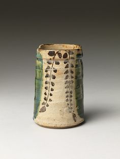 Oribe revival - Met Small Vase  Date:     19th century Culture:     Japan Medium:     Paste decorated under a thin, transparent glaze and thick overglaze (Mino ware, Oribe type) Dimensions:     H. 4 3/8 in. (11.1 cm)