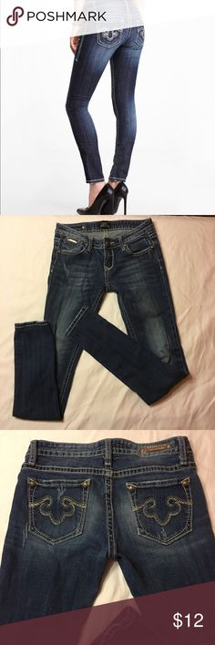 🌹Express jeans Pre loved Express Rerock jeans. Size 2 regular low rise skinny. 30 inch inseam 98% cotton 2% spandex. Medium washed dark meaning they have faded from washing. These are lightly distressed, so wear on pockets and around bottoms of legs blends in and looks like it was intended to be like that. Express Pants Skinny