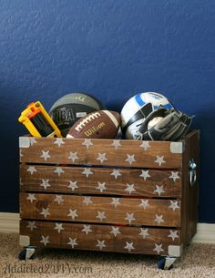Whether it's for stashing his toys, books or athletic equipment, this DIY Industrial Wood Crate Toy Box is perfect for bedroom storage!