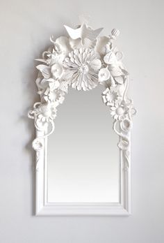 DIY ornate frame: Glue random small items together, spray paint all one color and attach to mirror. Perfect dollar store project, and would look cool in a bright colour for kids using dinosaurs or other small toys.