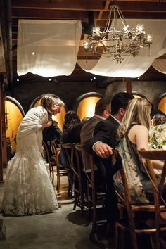 Bride + Groom greet the guests in the barrel room at Sattui