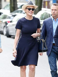 Star Tracks: Friday, September 11, 2015 | CLASSIC BEAUTY | Sharon Stone soaks up the last days of summer in a chic LBD (little blue dress) and red heels on her way to the Armani showroom in Milan, Italy, on Thursday.