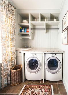 This Sandy Springs laundry room shows the trend for highly-functional one-stop laundry rooms with sinks for soaking, granite countertops for folding and an elegant organization system