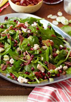 Special Spinach Salad – What makes this healthy living spinach salad special? Pomegranate seeds, crumbled feta, and bacon! Plus, it only takes 15 minutes to prepare.