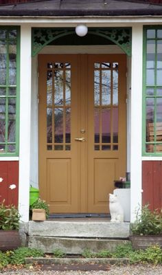 Check out this great metal garage doors - what an original style Metal Garage Doors, Garage Door Design, Stairs And Doors, Red Cottage, Porch Entry, Swedish House, Exterior Doors, Doorway, French Doors