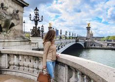 PONT ALEXANDRE III This decadent bridge, adorned with gilded sculptures and art nouveau lampposts, links the Champs-Élysées with the Left Bank. Add views of the Eiffel Tower and it's easy to see why this is one of most popular places for wedding photos in the City of Light.