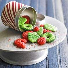These fun and colorful spritz cookies are only 100 calories per serving! More healthy cookie recipes: http://www.bhg.com/christmas/cookies/heart-healthy-christmas-cookies-bars/?socsrc=bhgpin121613easyspritz&page=18