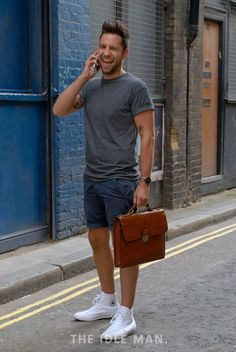 Men's Street Style | Office Casual - Switch up your office wear for the summer with a shorts and t-shirt combo. A sharp pair of clean white converse and briefcase smartens it up for the office. | Shop the look at The Idle Man
