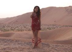 Sunset in the Liwa Desert, wearing a stunning red dress from For Love and Lemons