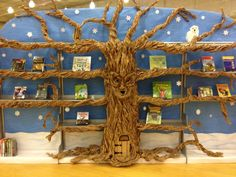 This wonderful magical tree is on display at our Central Library. Created by librarian Blythe and made of recycled paper packaging. It's name is Braeburn Greenleaf Goodwood III (an apple tree), and it changes with the season. Faeries live behind the little door.