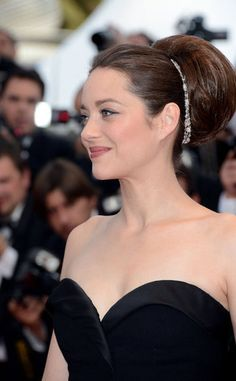 Marion Cotillard looking ultra elegant with an updo at Cannes Film Festival 2012