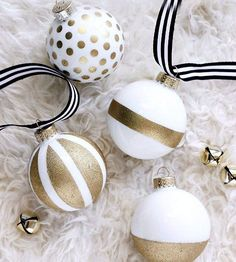 Create your own designer-style ornaments without the high-end price tag! The colorblock trend has been around for a while, but Cassie of Hi Sugarplum! uses it to spice up plain white ornaments with gold spray paint.