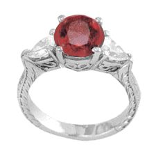 Ziamond Cubic Zirconia Ruby Engagement Ring 2 Carat Round & Pear 14K White Gold.  The Enchantress Ring features a beautiful ruby red round cubic zirconia center in an antique styled setting.  $1295 #ziamond #cubiczirconia #cz #engagementring #weddingring #ruby #diamond #jewelry