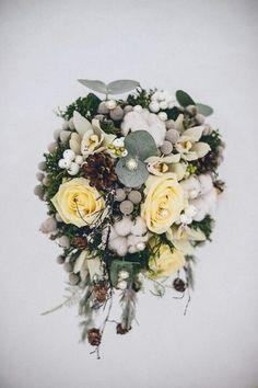 Unique Winter Wedding Bouquet: Pastel Yellow Roses, White Orchids, Raw White Cotton, Silver Brunia, White Snowberries, Pine Cones, Blue Eucalyptus Foliage